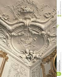 detail of plaster work on ceiling and walls at versailles palace