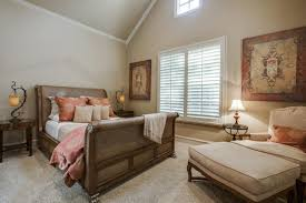 furniture vaulted ceilings and window blinds with bedroom wall