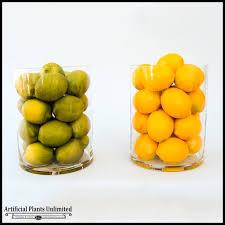 ornamental citrus fruit in glass vase