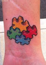 autism 3d puzzle pieces tattoo on wrist