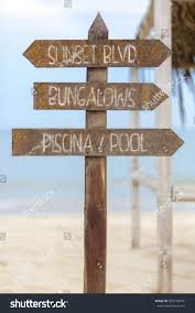 wooden sign post standing on beach stock photo 355578374