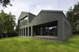 new modern home bauhaus style with an open floor plan and dark