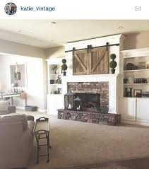 Fireplace Opening Covers by Mantle Barn Doors Over Tv Interior Barn Doors Pinterest