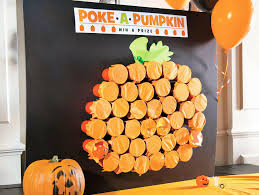 poke a pumpkin halloween party game could be adapted for