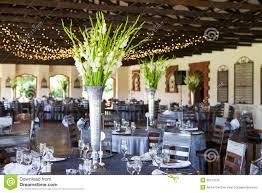 wedding reception venue with decorated tables and fairy lights