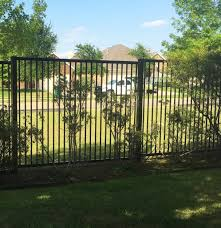 Metal Arbor With Gate Posts By Admin A Better Fence Company Aubrey Fence Companies