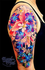 vivid shoulder and upper arm sleeve flower tattoo click to