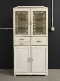 1940s kitchen cabinet vintage 1940s tall medicine cabinet glass doors white appliqué