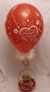 balloons with gifts inside wedding balloons fresh silk flowers pew end bows chair cover