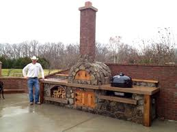 outdoor inspiring brick pizza oven with long chimney wood fire
