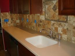 porcelain 4x4 kitchen tile backsplash with accent behind sink