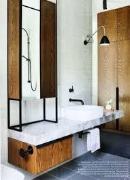 fashionable bathroom scandinavian style design with oval mirror on
