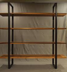 handmade floating walnut and steel bookcase by fabitecture