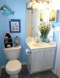 minimalis bathroom with blue sea color wall and white bathroom