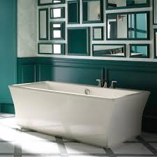 kohler bathroom design white bathtub with kohler faucet and ceramic flooring tile black