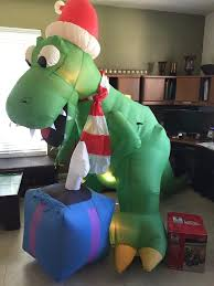 Christmas Yard Decor - 9 ft lighted holiday t rex dinosaur airblown inflatable christmas