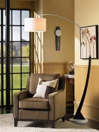 add style to a living room corner with an arc floor lamp room