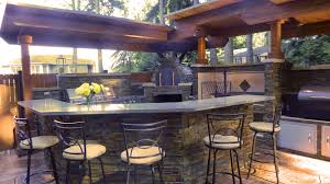 outdoor kitchen with argentinian grill brickwood pizza oven and