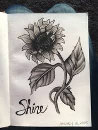 sunflower sketches on notebook paper the artwork and paper are on