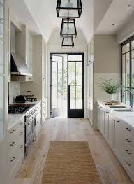 Design Ideas For Small Galley Kitchens by Kitchen Galley Kitchen With Wide Plank Floor And French Doors To