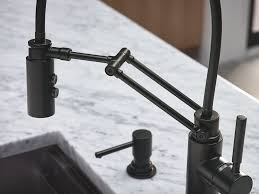collection solna finish matte black product single handle the solna articulating kitchen faucet by brizo in matte black was the hero in this modern kitchen space designed by