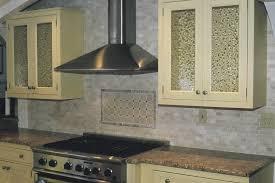 alluring natural stone tile kitchen backsplash features beige