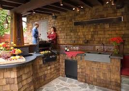 fair straight outdoor kitchen with stone covered outdoor kitchen