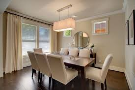 modern dining room with pendant light by john buchan homes