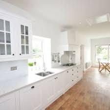 White Cabinets White Kitchen White Subway Tile Pot Filler Lyra - Silestone backsplash
