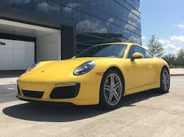 yellow porsche 911 porsche 911 carrera 2 review business insider