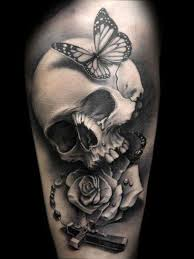 black and white skull bone with cross and roses tattoos