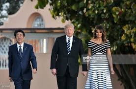 is trump at mar a lago us president donald trump and first lady melania trump walk with