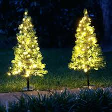 small artificial tree with lights colored trees medium