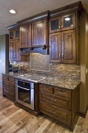 staining kitchen cabinets amazing rustic cabinets okay honey you gotta go tear the wood