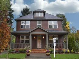 farmhouse home design with dark brown exterior colors and cute