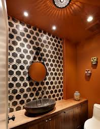 bathroom orange bathroom with hexagonal backsplash also circular