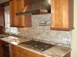 kitchen back splash in natural stone brick pattern granite
