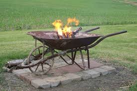 Old Fire Pit - clever uses for wheelbarrows you probably never considered