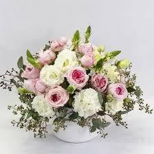 white flower arrangements pink bell