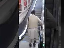 very funny video man on electric stairs musr see youtube