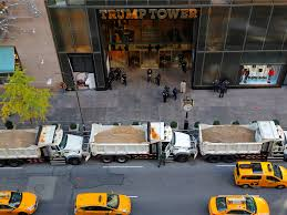 why trump tower is surrounded by dump trucks filled with sand for