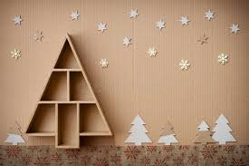 tree shaped gift box and decorations on cardboard