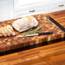 teakhaus by proteak teak serving cutting boards touch of modern butcher block collection rectangle grips small