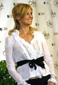 side view of pulled back hair in a bun faith hill with her long hair tied back closely to the head