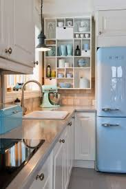 white kitchen cabinets what color walls navy blue kitchen accents get the look colorful retroinspired