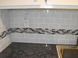 kitchen glass tile backsplash 22 light grey subway white grout with decorative line of mosaic