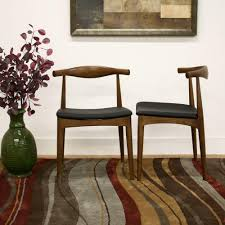 Mid Century Dining Chairs Upholstered Buy Baxton Studio Sonore Black Faux Leather Upholstered And Dark Brown