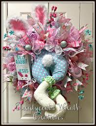 pink and blue bunny deco mesh wreath with sign that says