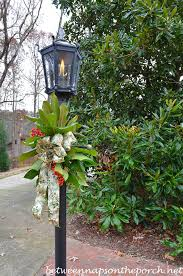 decorate a lantern for with greenery from the garden
