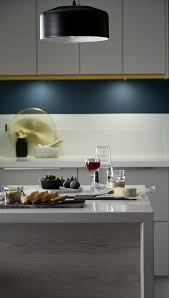 our greenwich dove grey kitchen range has a light grey slab cabinet